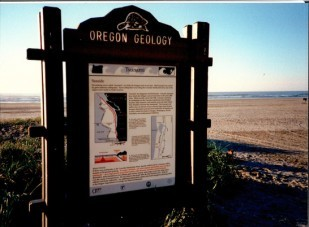 Historical marker about tsunamis, located in Seaside, Oregon.