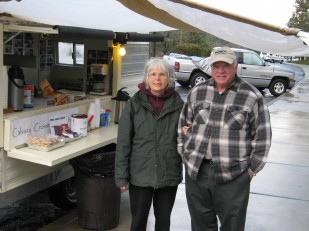 Photo of Rene and Jim Ford, Oregon Travel Experience free coffee program volunteers at Manzanita rest stop.