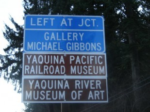 Image of an Oregon Travel Experience highway business sign known as a tourist oriented directional, or TOD or short.