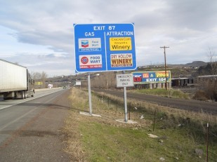 Image of Oregon Travel Experience highway business sign or Interstate logo sign.