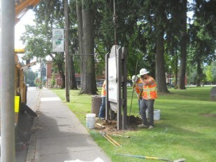 OTE highway business sign crew install an Oregon Historical Marker at Dayton
