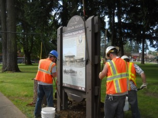 OTE crew and ODOT help secure the marker into the deep holes