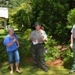 The park rangers chat with an audience member.
