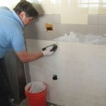 Barry Reed cleans fresh grout