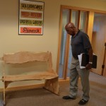 Image of Oregon Travel Information Council and Heritage Tree Committee member Ed Washington looks over the new bench.