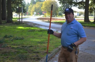 John Horton maintains his good humor while cleaning the rest area's main parking lot.