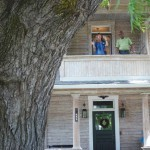 Heritage Tree Committee members, Nancy and Ed, admire the historic walnut from the balcony of the Christian Zimmerman House