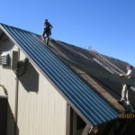 Workers install new roof