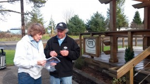 Tillamook Rest Area Specialist Dennis Worrel  helps a motorist looking for places to stop within Tillamook