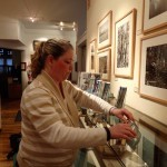 OTE's Jenn Smith helps set up the community reception at the museum