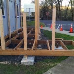 Framing begins on the new office ramp and deck.