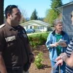 Yamhill County Deputy Sean Sato with Yamhill County Historical Society's Angela Speier.