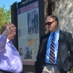 Preston Polasek discusses the history of the town square with the husband of Perkins' descendent Virginia Johnson.