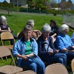 Guests enjoy the sunshine at the event.