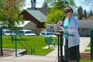 Perkins' descendant Virginia Johnson speaks to the students attending the ceremony.