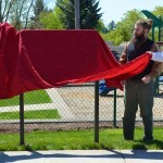 Johnson and nephews Weston and Ryan Renoud start to unveil the new marker.