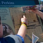 Students point out their homes on the antique map that Joel Perkins platted in the mid-1800s.