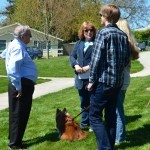 Lafayette Councilor G. Doug Cook, Marie Sproul, Brenda Polasek, and Levi Polasek with canine guest.