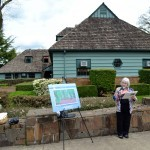 Marcia Whitlock of the Oregon Garden Clubs speaks to the significance of the club's 1940s efforts to save the myrtlewood trees.