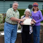 Rodger Brandt and grove nominator Nancy Appling (r) present the award to Marcia Whitelock for the Coquille Myrtle Heritage Grove.