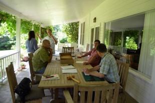 The Heritage Tree Committee met on the veranda of the McDonald's farm home.