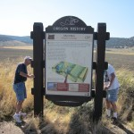 Volunteers inspect the Abert Rim Marker near Lakeview.
